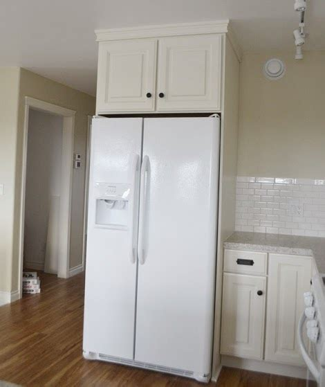 gap between fridge and cabinets boxing in fridge with cabinetry momplex vanilla kitchen