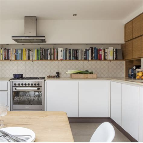 handleless kitchen with smart open bookshelf housetohome