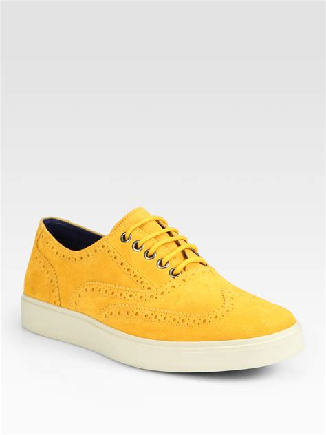 mens wingtip sneakers lyst cole haan bergen wingtip sneakers in yellow for