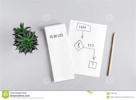 mock layout meaning business plan development with list and pencil desk