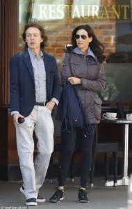 Paul Mccartney Stepping Out With A New Friend by Sir Paul Mccartney Has Tear In His Trousers While On A