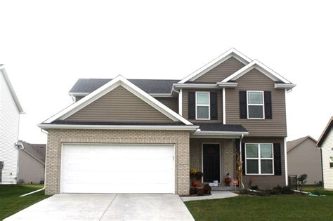 Brown Siding White Trim - 2 story house with brown siding white trim white