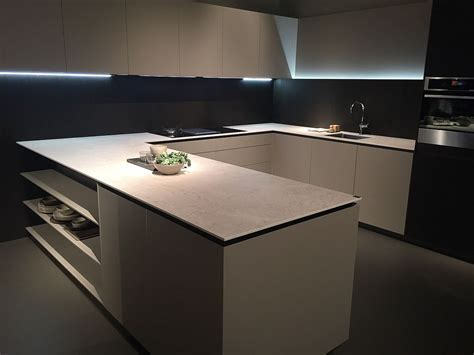 U shaped kitchen design with open shelves for the
