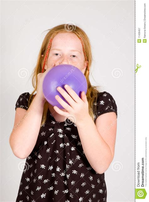 Girl is blowing up a balloon stock image image 11436457