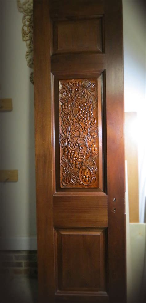 Low Relief Woodcarving on Antique Mahogany Doors
