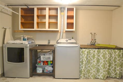 cabinet between washer and dryer 20 laundry room cabinets to try in your home keribrownhomes