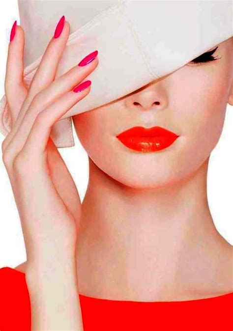 beautiful orange  red lipstick  purple nail polish