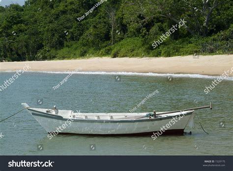 small fishing boats near me small white wooden fishing boat near stock photo 1529175