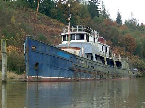 unturned big boat abandoned river boats west coast paddler sea kayak