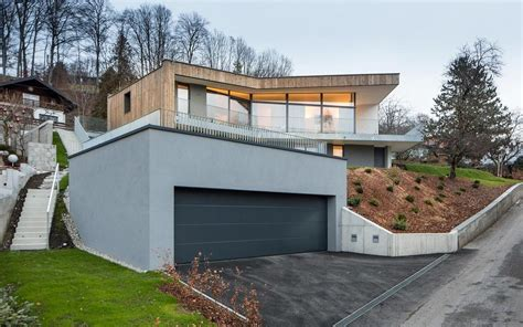 L Shaped Garages 3 storey home on steep slope with grass roofed garage