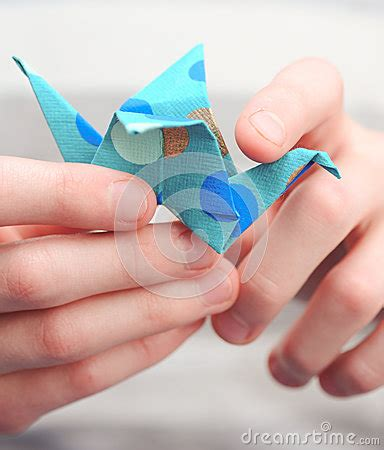 Origami Holding - child holding origami crane stock photo image 42056129