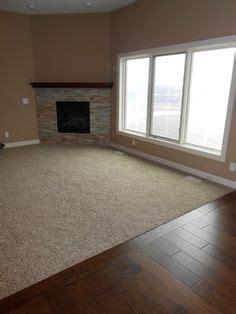 carpet inlay wood floor bordering 3 around room wall