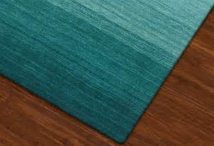teal colored area rugs teal area rug with borders interior home design
