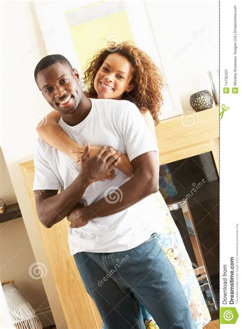 young couple room young couple embracing in living room royalty free stock