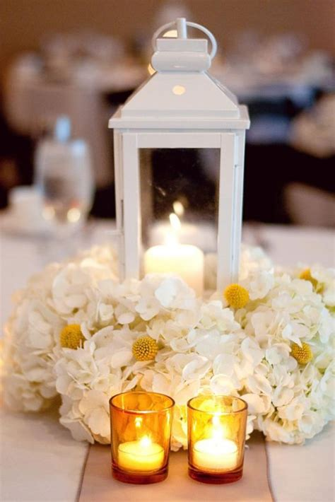lantern floral centerpieces lantern and flower centerpiece pictures weddingbee