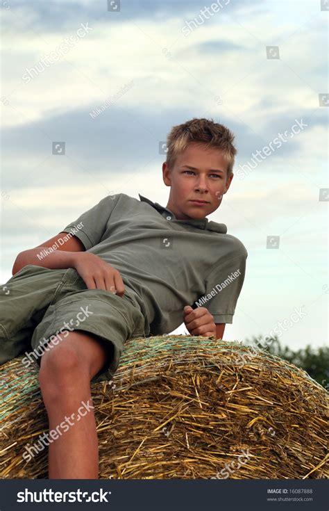 pojkart boys 13 years old boy on bale stock photo 16087888 shutterstock