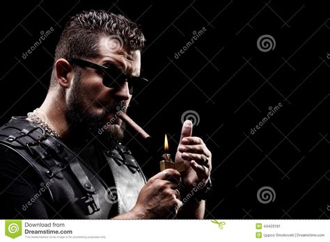 badass biker lighting up a cigarette stock image image
