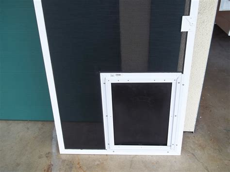 Sliding Screen Door With Pet Door Built In by Sliding Screen Door With Pet Door Built In Jacobhursh