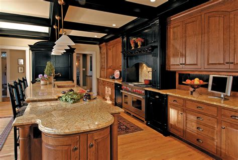 honey oak kitchen cabinets kitchen traditional with black