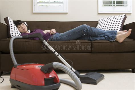 couch vacuum cleaner woman relaxing on couch with vacuum cleaner stock images