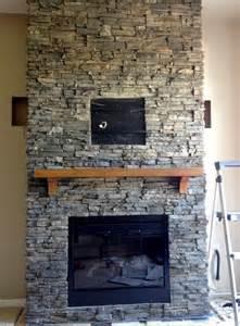 Stack stone fireplaces half indoor half outdoor