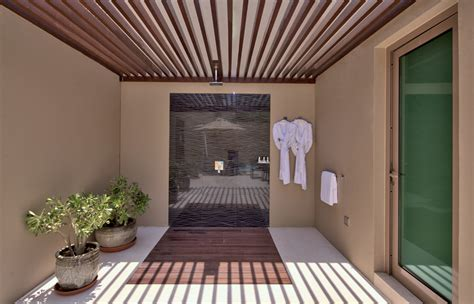 shower outdoors dubai desert palm dubai 171 luxury hotels travelplusstyle