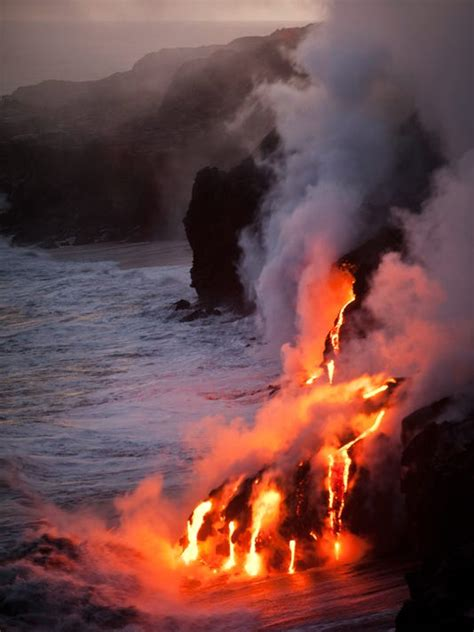 hawaii volcanoes national park lava glows steam shoots