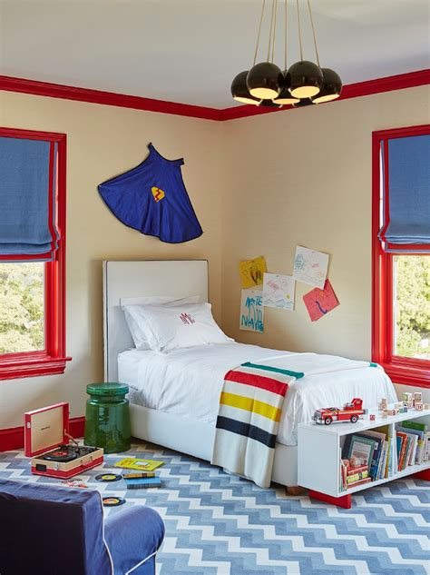 red and blue childrens bedroom superhero cape over kids bed design ideas