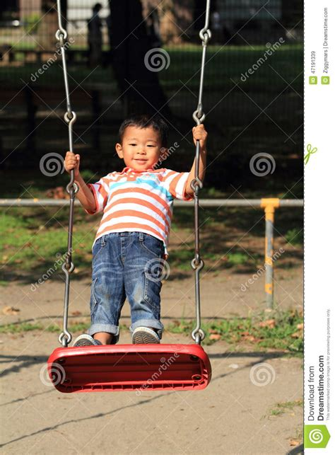 swing years japanese boy on a swing stock photo image 47191339