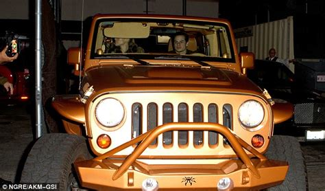 jlo new car sports steely expression on date with