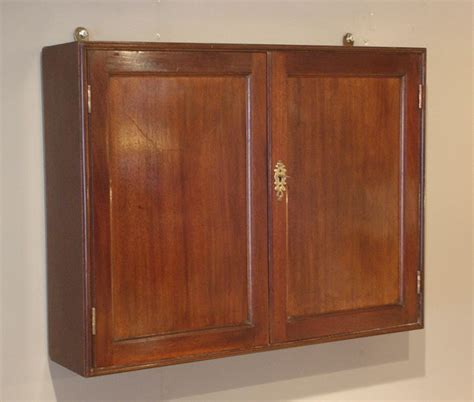 Small antique mahogany cupboard, antique wall hanging