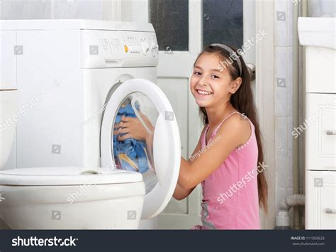 washing clothes in the bathtub beautiful girl washing clothes bathroom stock photo
