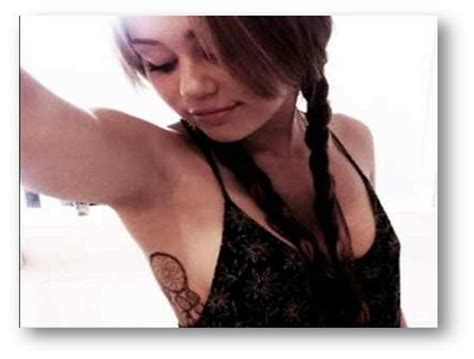 miley cyrus s tattoos new pictures miley cyrus