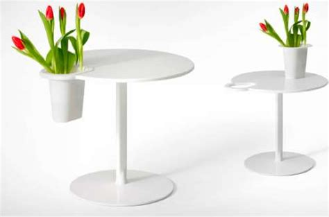 Vase On A Table by Vase Clenching Coffee Tables Grip Satellite Table