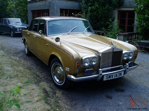 gold rolls royce rolls royce brown gold