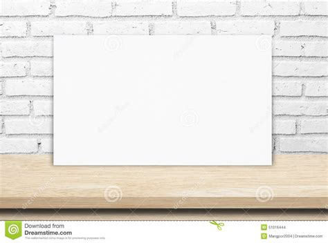 wall post template blank white paper poster wood table and brick wall