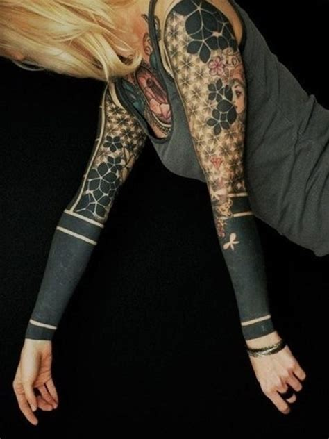 womens tribal sleeve tattoos black ink dotwork on sleeve