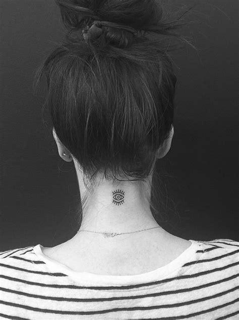 evil eye tattoo behind ear tattoologist