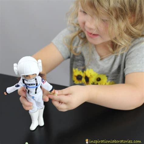 lottie doll astronaut fossil sensory bin with lottie dolls inspiration