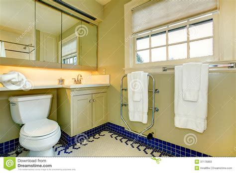 Cleaning Yellow Bathroom Tiles Bright Yellow Bathroom With Blue Tile Floor Stock Photos
