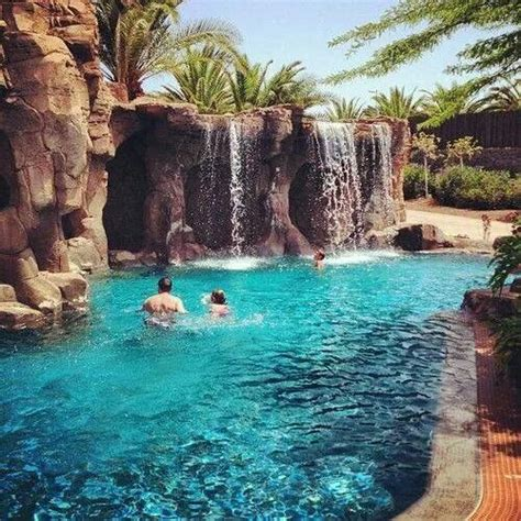 grado pool grado style with waterfall flowing into a pool great