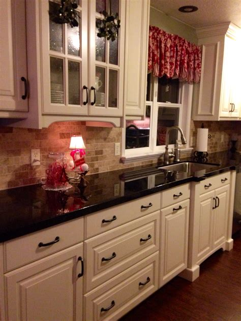 white cabinets with black granite off white cabinets brazilian marron cohiba granite