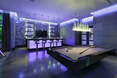 one room game modern game room with chandelier hardwood floors in