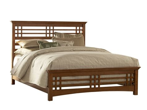 brown wooden bed frame with headboard and white striped