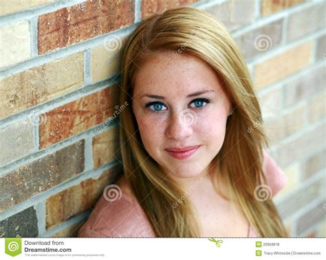 tween freckles smiling redhead teen girl with freckles stock photo