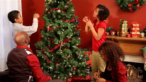 christmas tree a family finishes decorating their