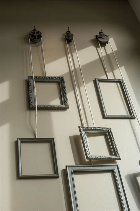 wall hanging photo frames ideas decorative frames hang from pulleys photos diy