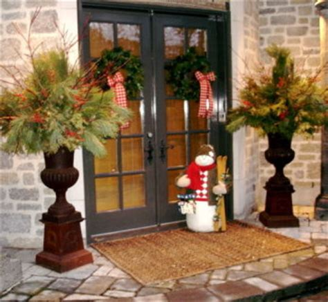 christmas decorating huge stone urns in front of entrance outdoor urn decor decoration news