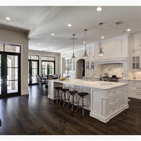 Love the contrast of white and dark wood floors! By