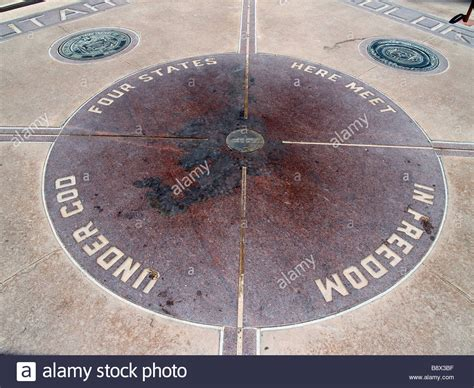 Four Corners the marker at four corners usa indicating the quadripoint